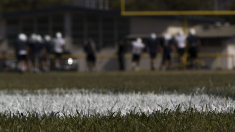 Cam High Scorpion football team practicing on the veteran field.