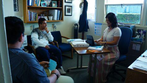 Kim Stephenson, associate principle, working with students.