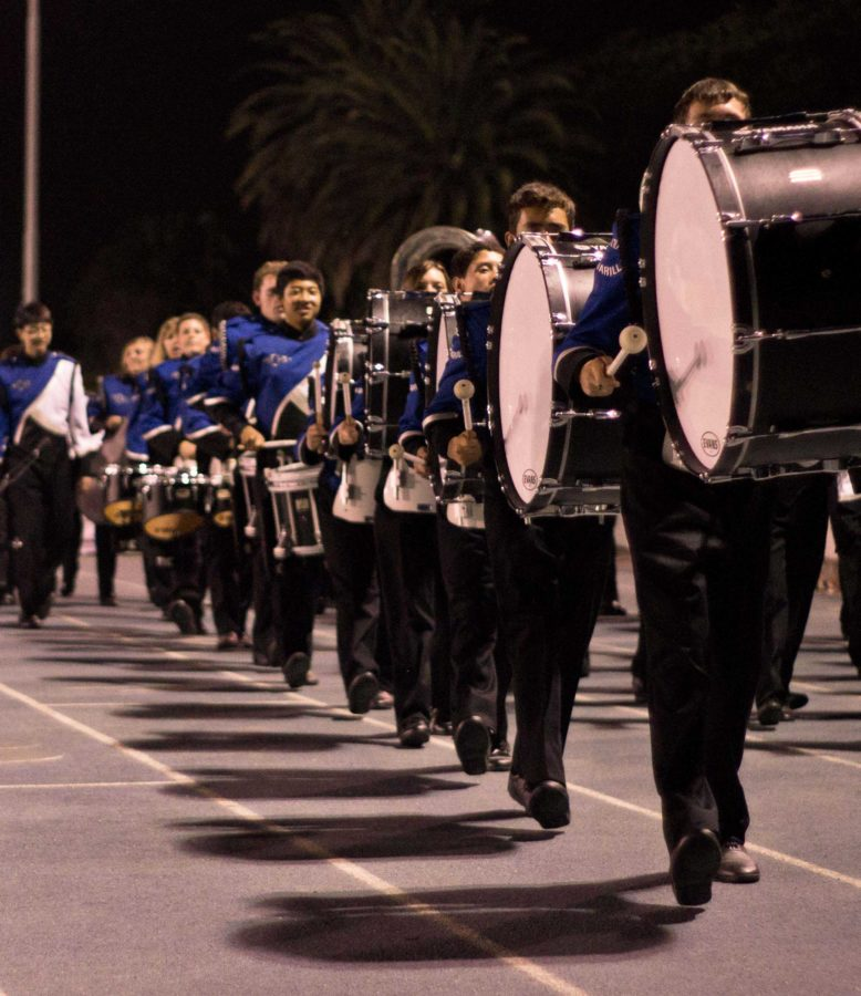 Cam High's Marching Band marches to the field. Director Mr. John Stava said the band's improvement this year has been