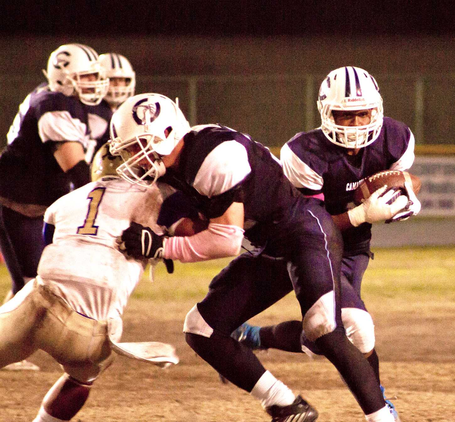 Cam High takes a hand off to score a touchdown against Channel Islands.
