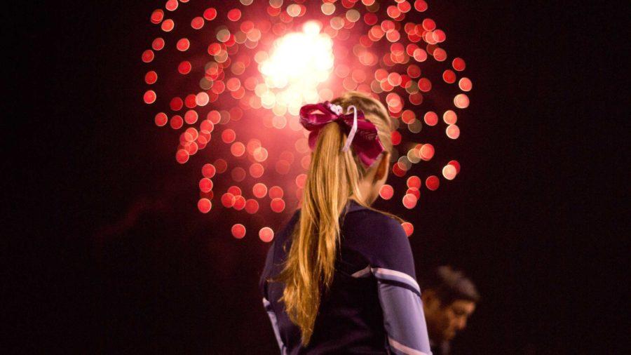 Cam High cheerleader, Tori Bertok, freshman, spectating the firework show.