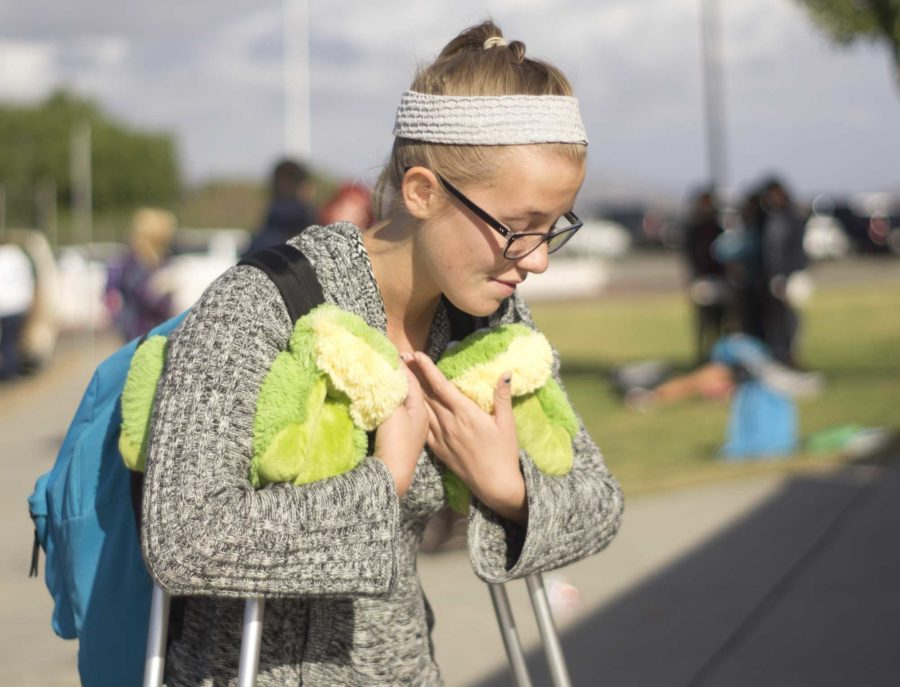 Haylee Flores, waiting for her ride at the front of the campus.