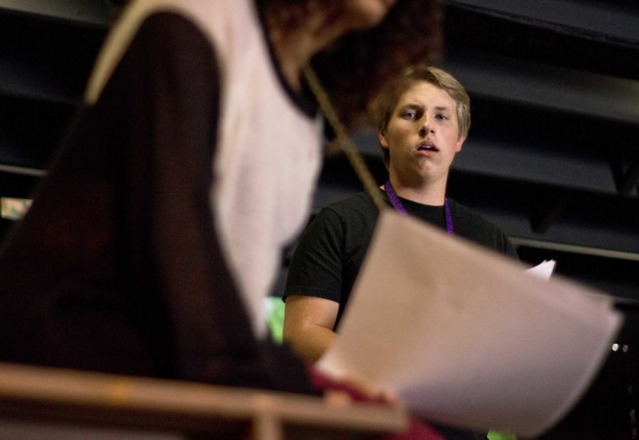 Jack Johnson, senior, runs lines with Christine Ibrahim, senior in preparation for Death Takes a Holiday.