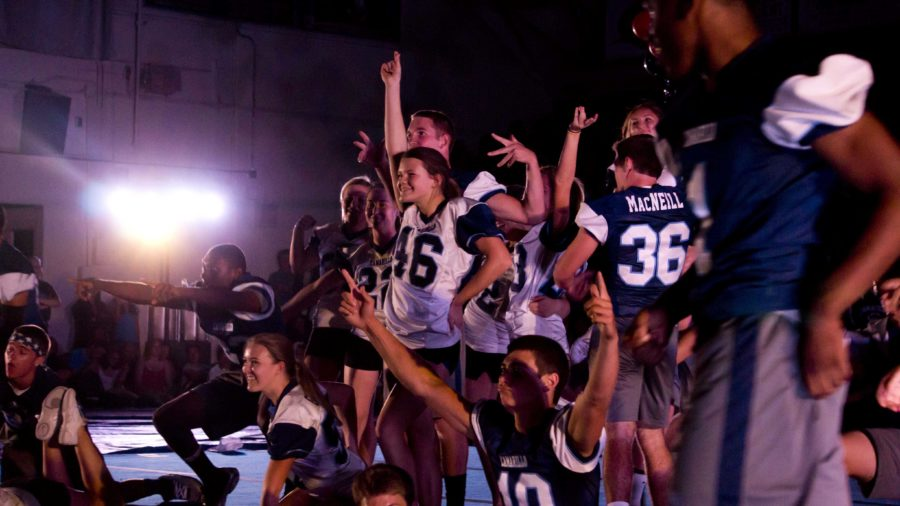 The Cam High football team and the cheer team perform in front of hundreds of students at the Rival Rally.
