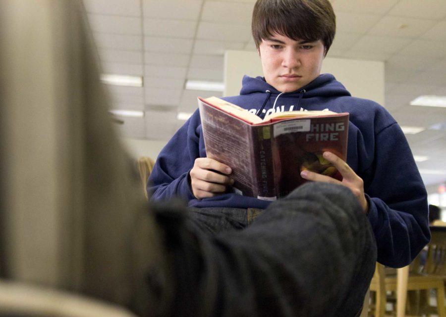 Troy LeDuc, senior, catches up on reading
