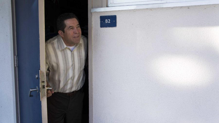 Mr. Pascual Campos looks out the door of room B-2, the scene of an attempted burglary Friday morning.