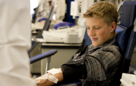 Jayson Hansen, senior, getting his blood taken on the second day of the blood drive.