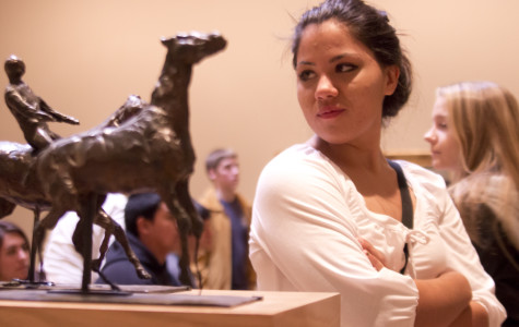 A miniature statue catches senior Jasmine Jacquez's eye at the
