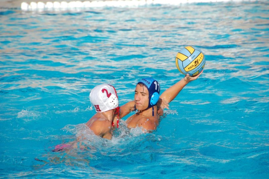 Zack+Zeider%2C+senior%2C+protects+a+Water+Polo+ball+during+a+game+against+Hueneme+High+School.