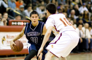 Jacob Alonzo, senior, dribbles the ball as Camarillo's captivated audience awaits the following few seconds.