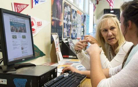 Mrs. Debbie Prentice assists Maesie Andrews in her college application.