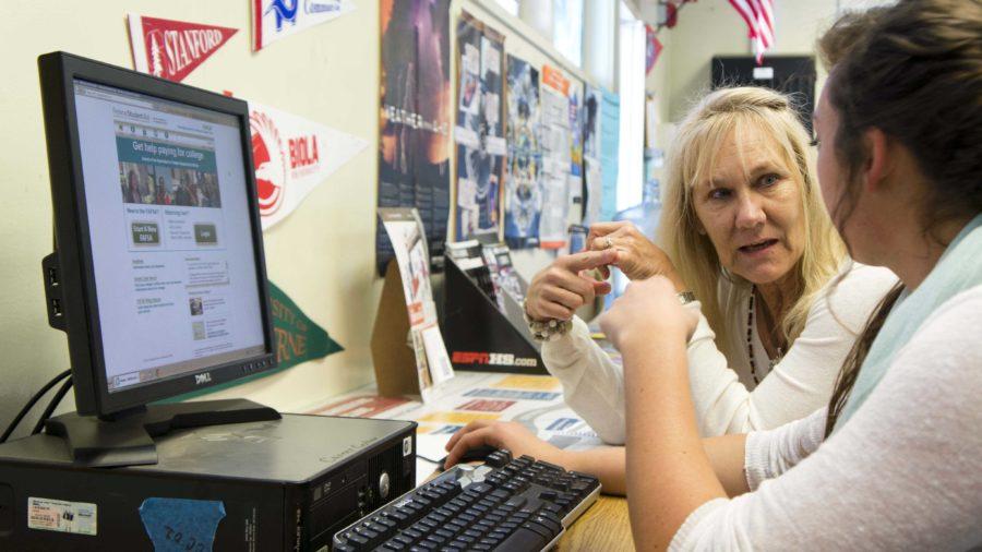 Mrs.+Debbie+Prentice+assists+Maesie+Andrews+in+her+college+application.