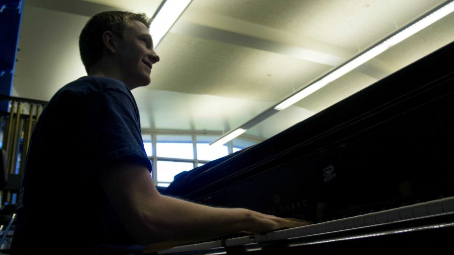 David Gatchel, junior, plays on the grand piano located in the band room.