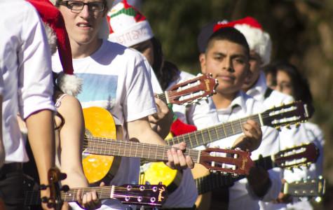 Nick Czajka, junior, a guitarist in Mariachi, strums his guitar during Camarillo's 2013 Christmas Parade.