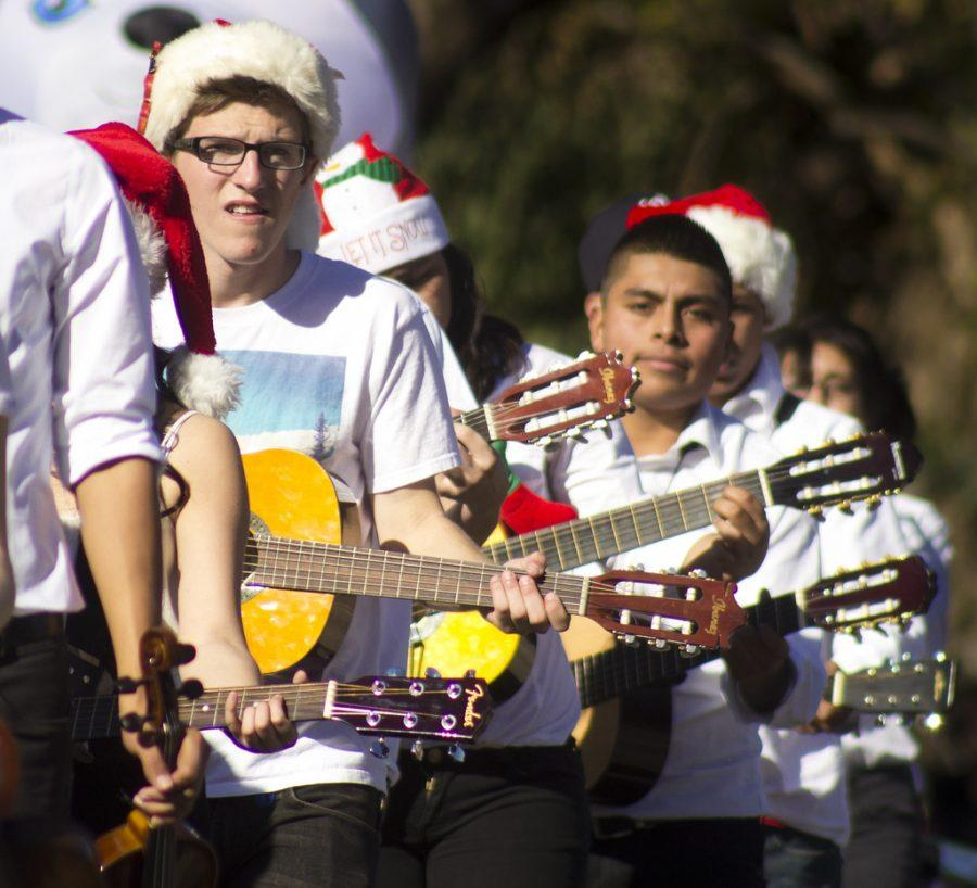 Nick+Czajka%2C+junior%2C+a+guitarist+in+Mariachi%2C+strums+his+guitar+during+Camarillo%27s+2013+Christmas+Parade.