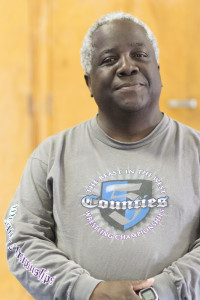 Cam High's Wrestling Coach, Ronald Wilson, smiles for the camera.