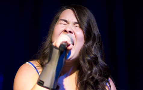 Mikaela Hurshman, junior, belts out a song during February's Camchella concert.
