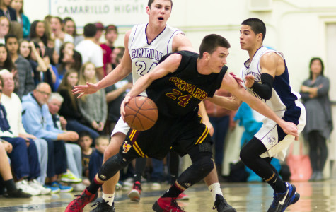 Gavin Hale, sophomore, and Jacob Alonzo, senior, corner an Oxnard opponent before he attempts a 3-point shot.