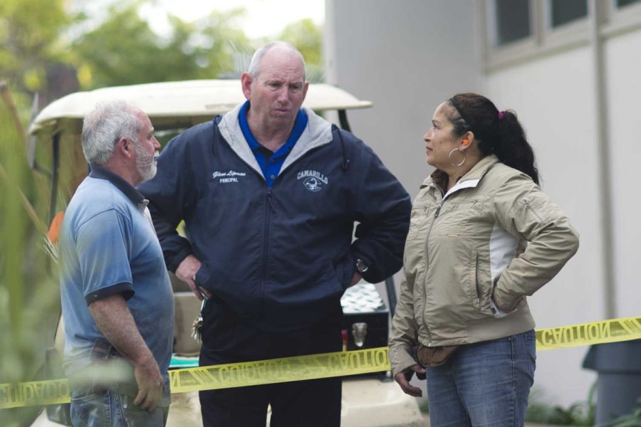 Cam High Principal Glenn Lipman talks to maintenance workers at site of water leak on Cam High Campus Thursday.
