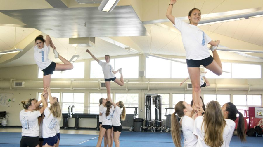Cam High's cheer squad practices in the cafeteria