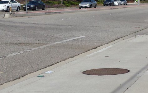 A car hit a cyclist at the western entrance to Cam High on Tuesday. Traffic concerns are being addressed daily by school officials.