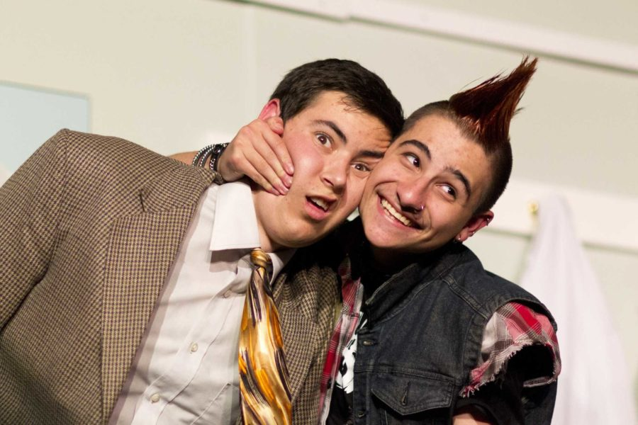 Noah Snair smudges his hand against senior Michael Griffins face during the 2nd night of It Runs In the Familys production.
