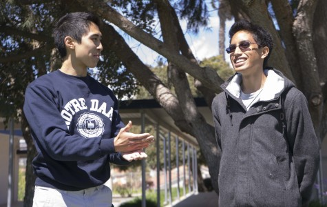 Tyler Duffy, Senior, and Christian Ramos, Senior, discussing how schemes operates.