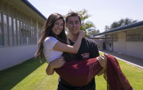 Michael Griffin and Danika Elvine, seniors, prep for the prom. Griffin worked to earn the money for the two tickets.