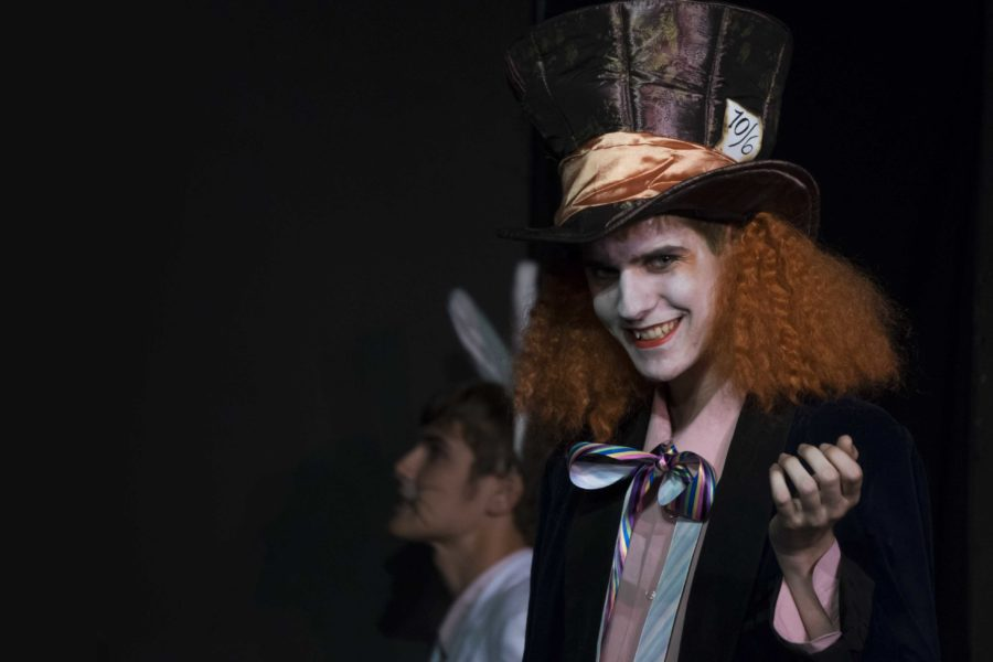 Brandon Sawyer, junior playing the Mad Hatter, discusses his daily tea time with Alice.