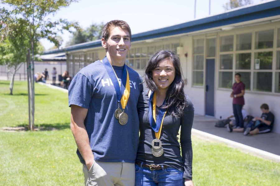Cam High seniors, Vivian Le and Jonathan Meier proudly display they're valedictorian and distinguished honors medals that they received at the community scholarships award night.