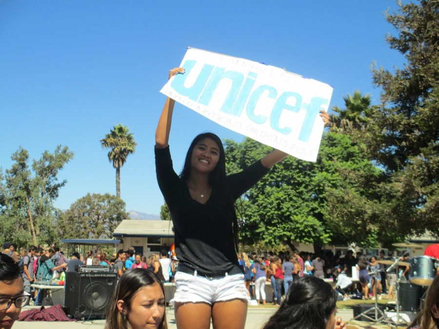Chelsea DeVera, senior, advertises with handmade posters for Unicef during  Club Rush.