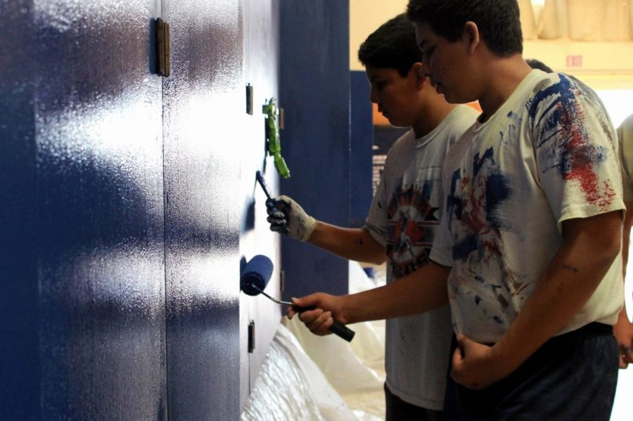 Adrian+Garcia%27s+friends+help+paint+the+wrestling+room+cabinets+as+part+of+Garcia%27s+Eagle+Scout+Service+Project.