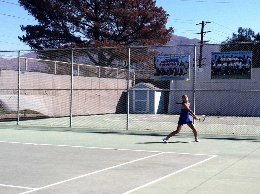 Makayla Byerly, junior, returns a lob from Simi Valley's team. Byerly and the Scorps went on to win the match.