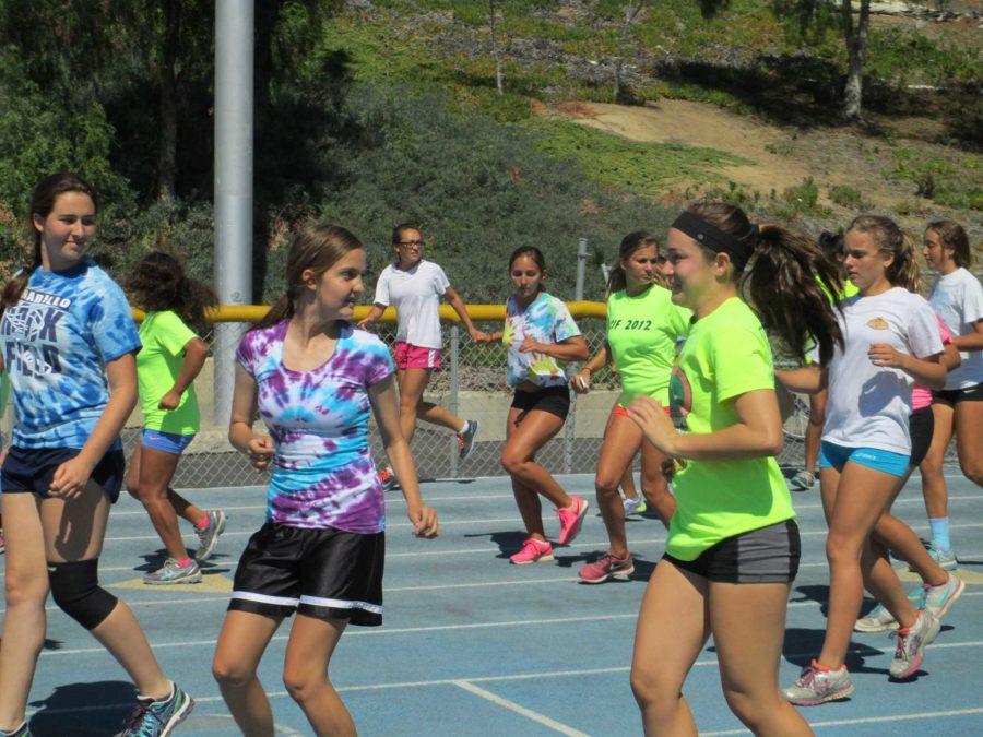 Girls+from+Cam+High%27s+track+team+perform+warm-ups+Thursday.+Cam+High%27s+track+team+will+begin+competing+in+the+Coastal+Canyon+league+from+now+on.