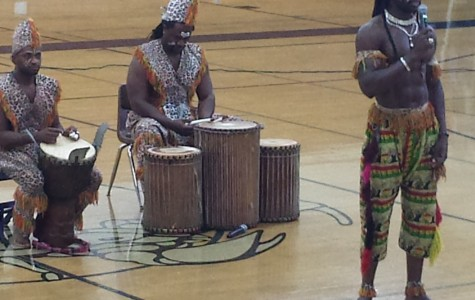 Students enjoy the African Dance and Drum Troupe during the 2nd period Distinguished Student Assembly by either watching or participating.