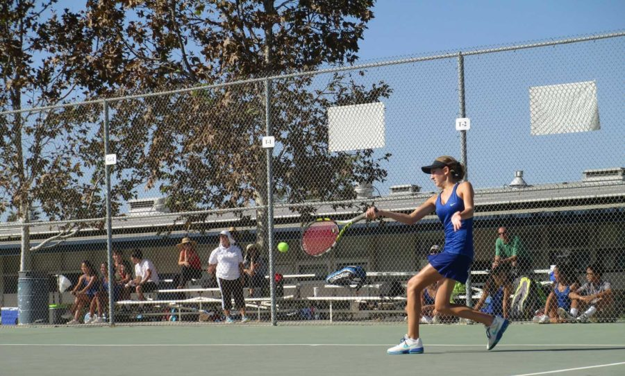 No. 2 varsity singles player Tatiana Anderson goes for the win on the Cam High girl's tennis team.