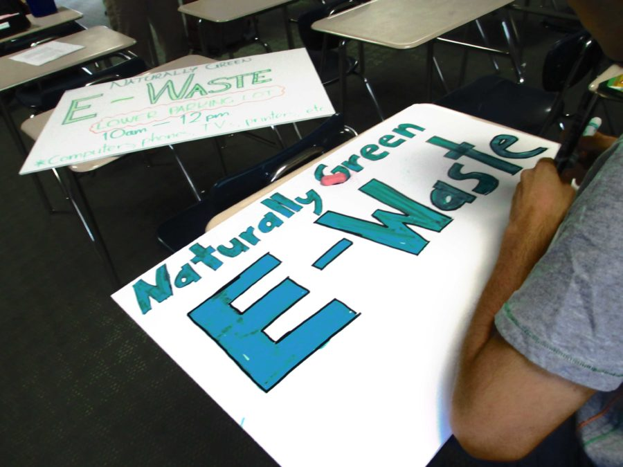 Naturally Green members make posters to publicize their e-waste recycling event to be held this Saturday.