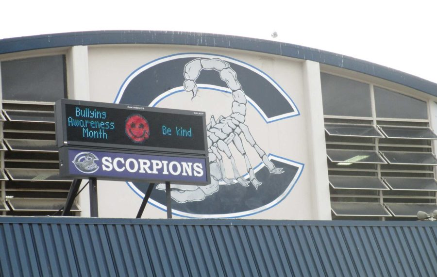 The marquee from atop the gym advertises club  meetings, school events, and birthdays to the buzz of students around the Scorpion Dome.