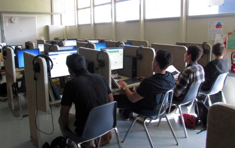 Students in Ms. Garcia's French 2 class work on their online final in the language lab.