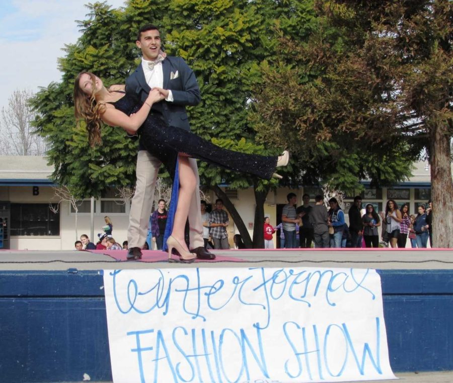 Senior Christian Willey and junior Nicole Weems pose for the crowd at this year's Winter Formal fashion show.