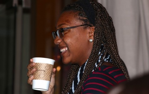 Students like Tiara Sivells (pictured above), junior, were invited to enjoy warm drinks and live entertainment in order to help raise funds for the EF tours.