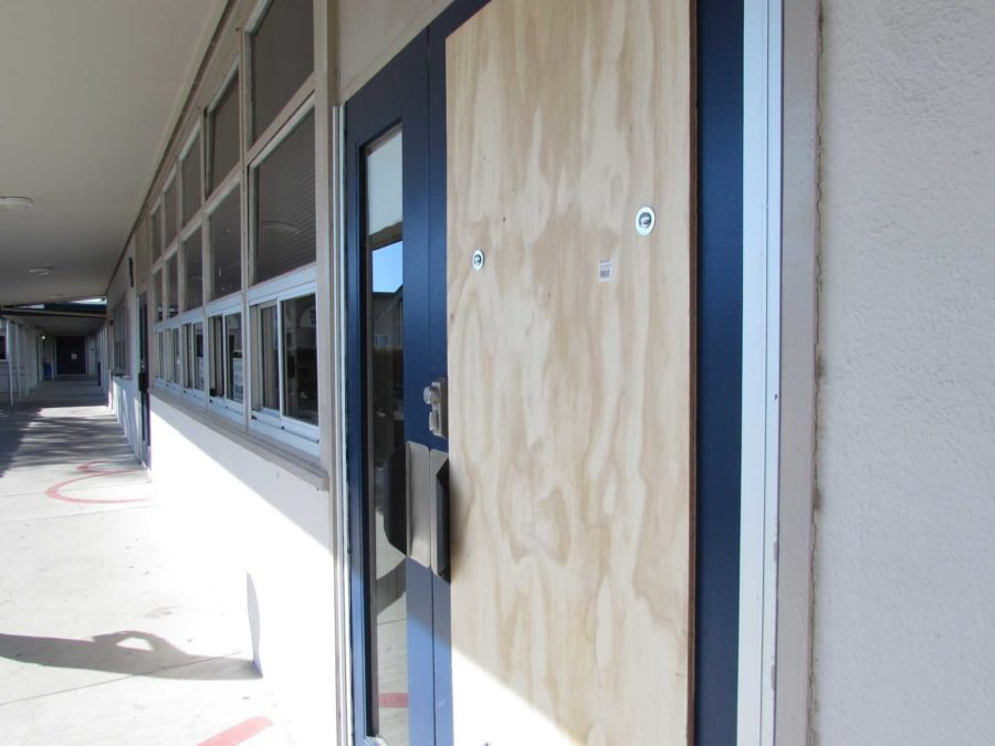 School administrators used a wooden plank as a temporary replacement for the glass screen of the main office door.