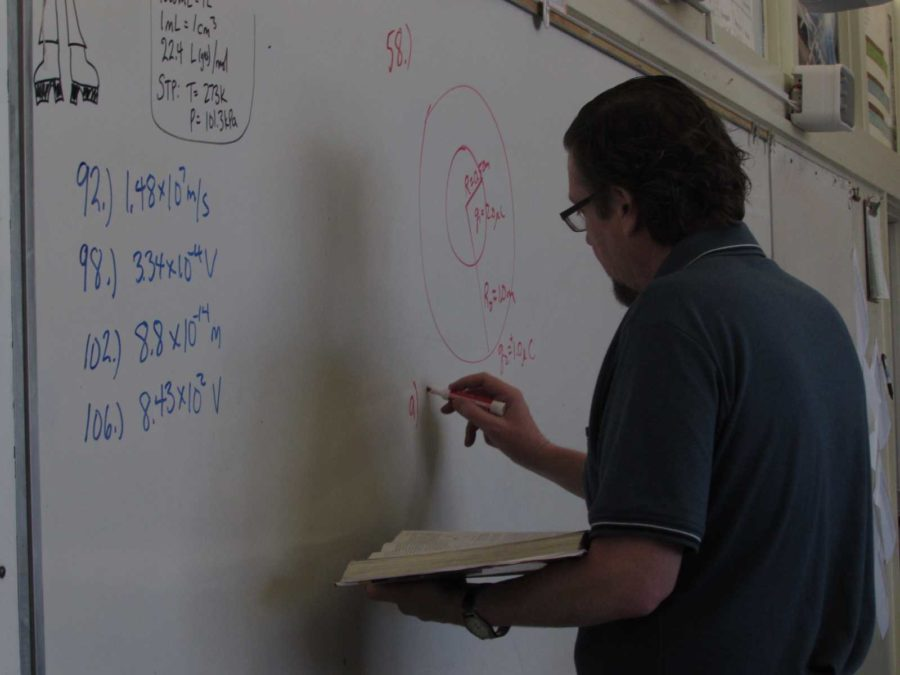 Mr.+Donald+Crowell%2C+AP+Physics+teacher%2C+goes+over+a+lesson+in++formulas.