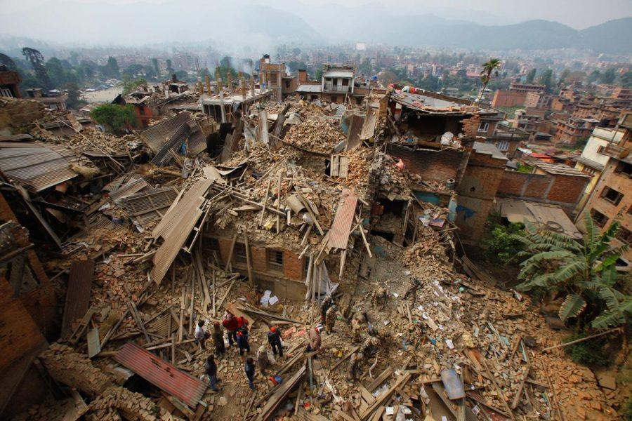 Mountains of debris have piled up in Nepal's capital. Here, rescue workers search for survivors on Sunday in Bhaktapur, near Kathmandu.