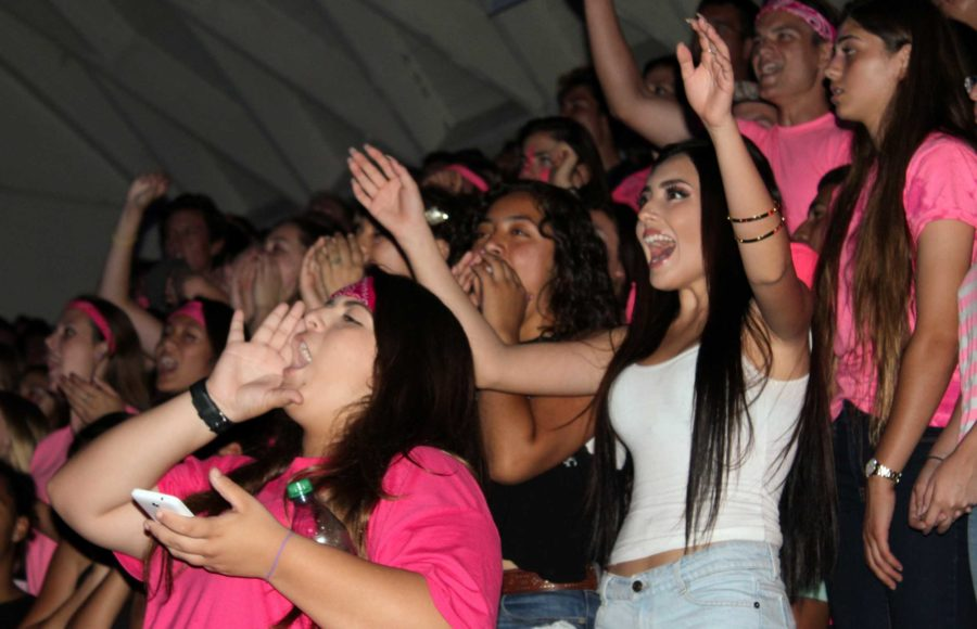 Seniors dressed in pink cheering at the traditional class call.