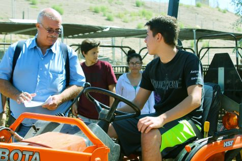 Mr. Swanson working with Mason Ecsedy, freshman, as part of the Agricultural Academy