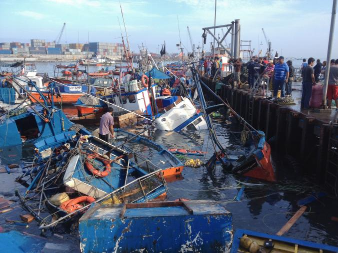 Fishing boats were destroyed in Iquique, Chile, when a powerful 8.2-magnitude earthquake hit off the country's Pacific coast. The rural surroundings of the quake's epicenter in Coquimbo, Chile has kept the quake's damage at a lower tier than that of 2010.