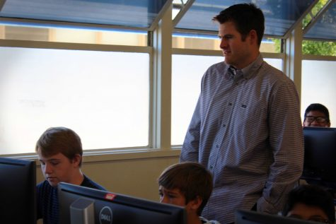 Mr. Foster, working with his students in his Business and Technology class