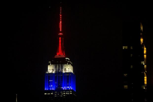 The Empire State building in New York, lit in the colors of the French Flag after the shooting in Paris.