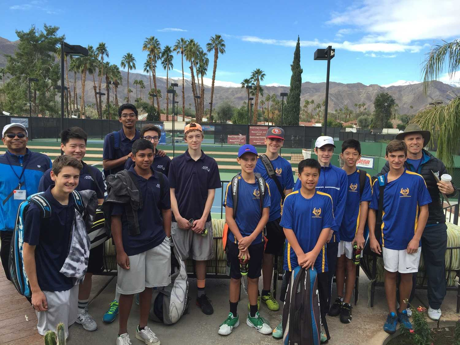 The Cam High (left) and Los Cab (right) boys tennis teams pose for a picture before their tournament.